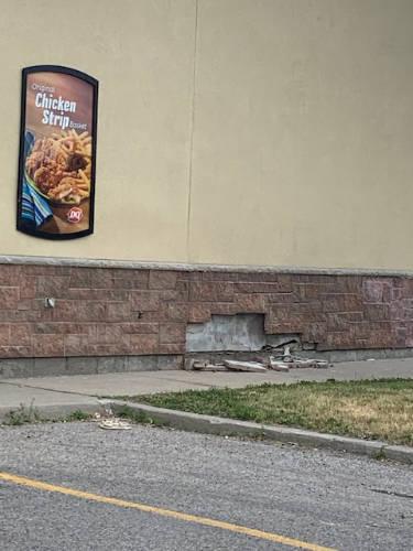 bricks falling off a wall