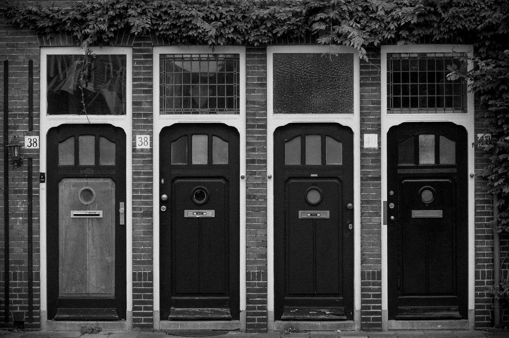 row of doors in black and white